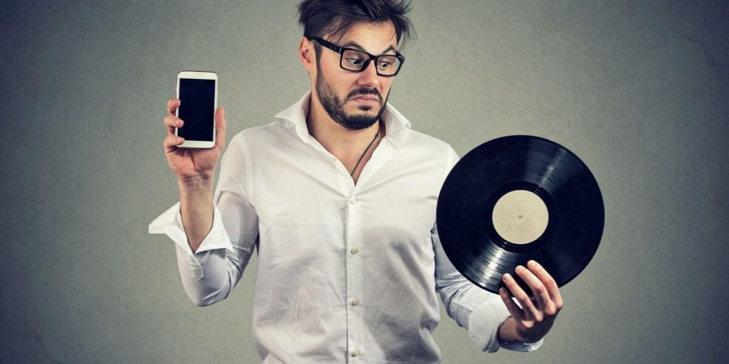Nel marketing immobiliare come nella musica: la sfida tra il fascino del vinile e l'efficienza del digitale